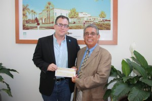 Matt Asner receives $10,000 donation from Sal Flores on behalf of the Irving J. Moskowitz Foundation for the non-profit organization Autism Speaks. The check presentation was done at the Hawaiian Gardens Bingo Club on Tuesday. Daniel E. Beckham Photo.