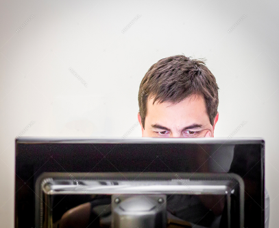 person behind computer screen