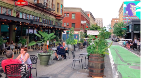 """Diners from two restaurants in Portland, Oregon, Zeus Cafe and Jake's, enjoy the newly reclaimed street space next to a """"bicycle boulevard"""""""