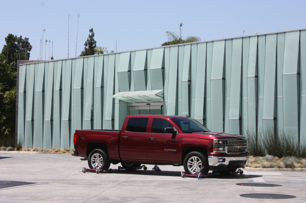 A new cherry red 4-door Silverado truck glistens during a commercial being filmed in Cerritos on Monday. Randy Economy Photo