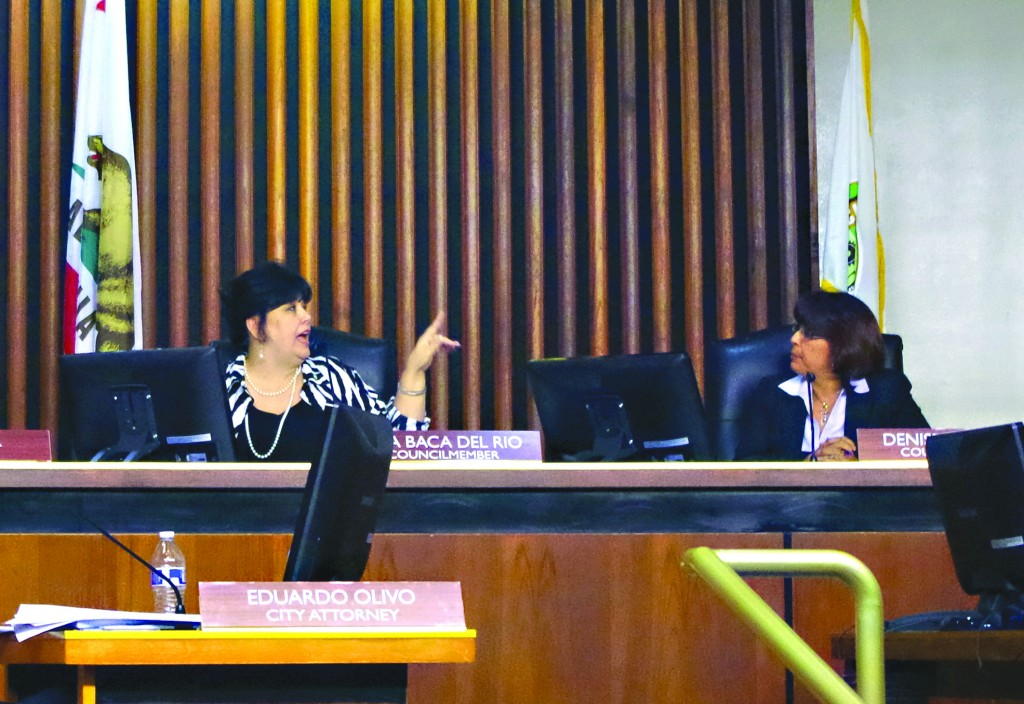 Commerce City Council Member Tina Baca Del Rio flashes hand gesture to rival council member Denise Robles during a heated meeting this past Tuesday.  Kristin Grafft